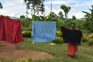 The Water Project: Mundoli Community, Pamela Atieno Spring -  Hanging Clothes To Dry