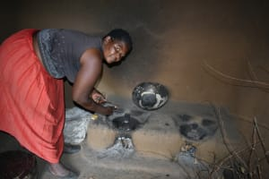 The Water Project: Mundoli Community, Pamela Atieno Spring -  Cooking Inside The Kitchen