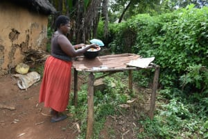 The Water Project: Mundoli Community, Pamela Atieno Spring -  Setting Dishes To Dry