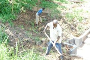 The Water Project: Maraba Community, Nambwaya Spring -  Backfilling With Soil Over The Tarp
