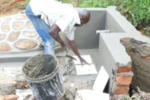 The Water Project: Maraba Community, Nambwaya Spring -  Fitting The Tiles