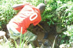 The Water Project: Maraba Community, Nambwaya Spring -  Identifying Spring Eyes During Excavation