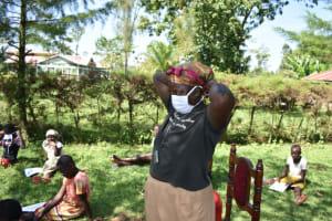 The Water Project: Maraba Community, Nambwaya Spring -  Putting On Masks
