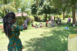 The Water Project: Maraba Community, Nambwaya Spring -  Trainer Elvin Demonstrates Handwashing