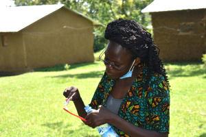 The Water Project: Maraba Community, Nambwaya Spring -  Trainer Elvin Shows Toothbrushing