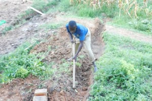 The Water Project: Maraba Community, Nambwaya Spring -  Digging Diversion Channel