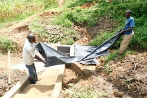 The Water Project: Maraba Community, Nambwaya Spring -  Fitting The Tarp