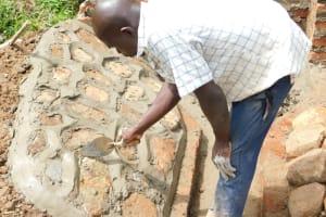 The Water Project: Maraba Community, Nambwaya Spring -  Plastering The Stone Pitching To Form Rub Wall