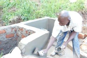 The Water Project: Maraba Community, Nambwaya Spring -  Plastering The Walls