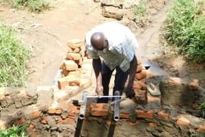 The Water Project: Maraba Community, Nambwaya Spring -  Setting The Pipes