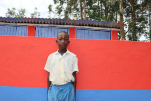 The Water Project: Ivakale Primary School & Community - Rain Tank 1 -  Brian Poses In Front Of The Latrines