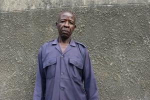 The Water Project: Ivakale Primary School & Community - Rain Tank 1 -  Security Guard Ernest Ambani