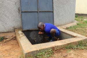 The Water Project: Kapkoi Primary School -  Boy Drinking Water