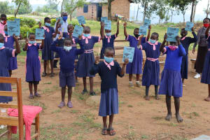 The Water Project: Kapkoi Primary School -  Students Pose With Their Training Journal