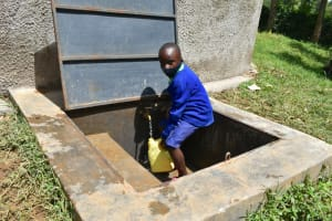The Water Project: Boyani Primary School -  Collecting Water