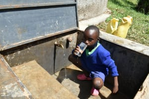 The Water Project: Boyani Primary School -  Drinking Water From The Tank