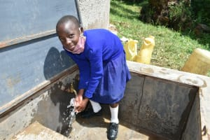 The Water Project: Boyani Primary School -  Pupil Washing Hands