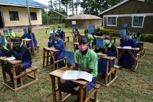 The Water Project: Boyani Primary School -  Showing Training Workbooks