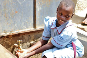 The Water Project: Mukoko Baptist Primary School -  Student Enjoys Water At The Tank