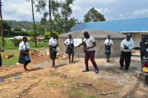The Water Project: Kinu Friends Secondary School -  Explaining Cut Off Channel Purpose