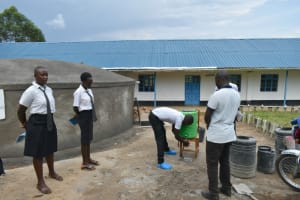 The Water Project: Kinu Friends Secondary School -  A Student Demonstrates Handwashing