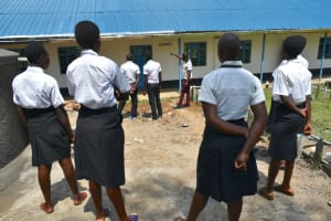The Water Project: Kinu Friends Secondary School -  Explaining How The Gutters Work And Should Be Cleaned