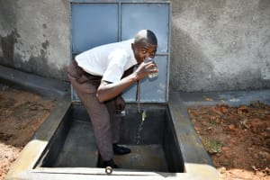 The Water Project: Friends Kisasi Secondary School -  A Student Enjoying Clean Water