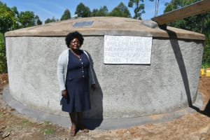 The Water Project: Friends Kisasi Secondary School -  Principal Florence Adenyi At The Tank