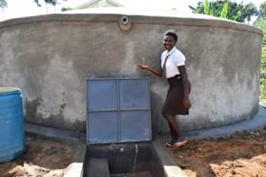 The Water Project: Friends Kisasi Secondary School -  Student Posing By The Water Tank