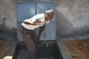 The Water Project: Friends Kisasi Secondary School -  Student Posing With Water At Drawing Point