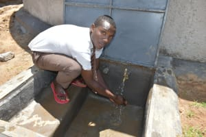 The Water Project: Friends Kisasi Secondary School -  Student Washing Hands At The Rain Tank