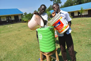 The Water Project: Friends Kisasi Secondary School -  Refilling Handwashing Station