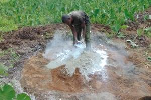 The Water Project: Mahira Community, Anunda Spring -  Mixing Cement