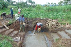 The Water Project: Mahira Community, Anunda Spring -  Foundation Laying