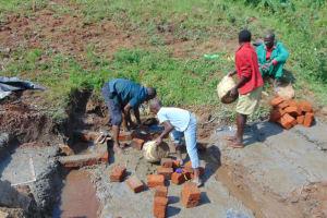 The Water Project: Mahira Community, Anunda Spring -  Brick Laying