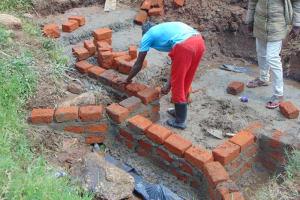The Water Project: Mahira Community, Anunda Spring -  Wall Construction