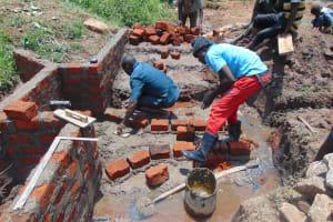 The Water Project: Mahira Community, Anunda Spring -  Drawing Point Construction