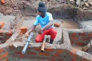 The Water Project: Mahira Community, Anunda Spring -  Pipe Setting