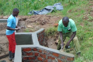 The Water Project: Mahira Community, Anunda Spring -  Exterior Plastering