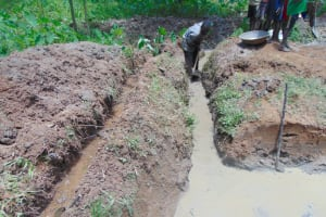 The Water Project: Nguvuli Community, Busuku Spring -  Digging The Drainage Channel