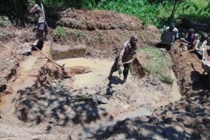 The Water Project: Nguvuli Community, Busuku Spring -  Spring Site Excavation