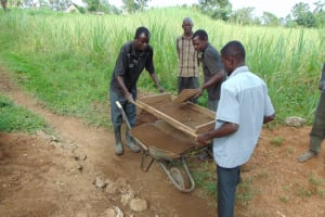 The Water Project: Nguvuli Community, Busuku Spring -  Community Members Help Sift Sand