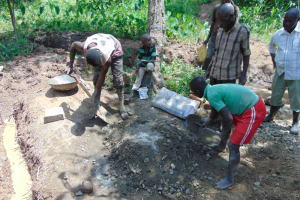 The Water Project: Nguvuli Community, Busuku Spring -  Mixing Cement