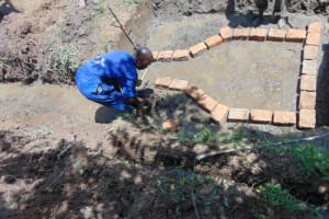 The Water Project: Nguvuli Community, Busuku Spring -  Brick Setting