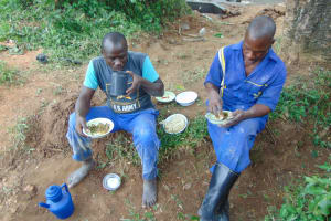 The Water Project: Nguvuli Community, Busuku Spring -  Artisans Having Lunch