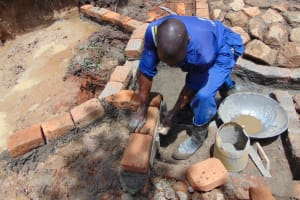 The Water Project: Nguvuli Community, Busuku Spring -  Wall Construction