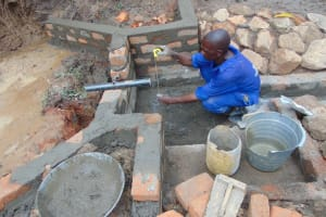 The Water Project: Nguvuli Community, Busuku Spring -  Pipe Setting And Measurements