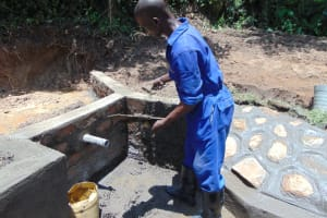 The Water Project: Nguvuli Community, Busuku Spring -  Plastering