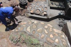 The Water Project: Nguvuli Community, Busuku Spring -  Rub Wall Construction
