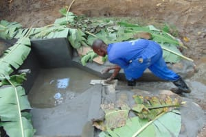 The Water Project: Nguvuli Community, Busuku Spring -  Plastering Spring Floor